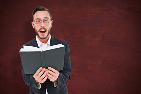 preacher: Young preacher reading from bible against desk
