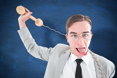 phone cord: Geeky businessman being strangled by phone cord against blue chalkboard