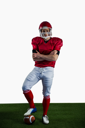 arms crossed: Portrait of american football player with arms crossed on american football field Stock Photo