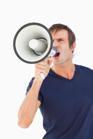 furious: Megaphone held by a furious man against a white background LANG_EVOIMAGES