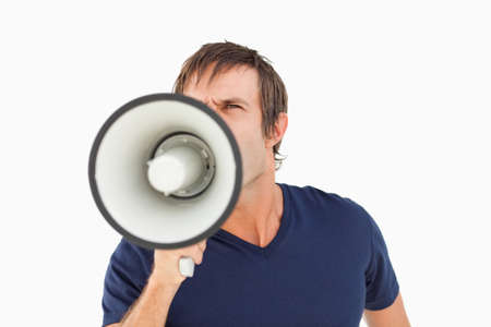 one mid adult male: Furious man holding a megaphone while standing up against a white background
