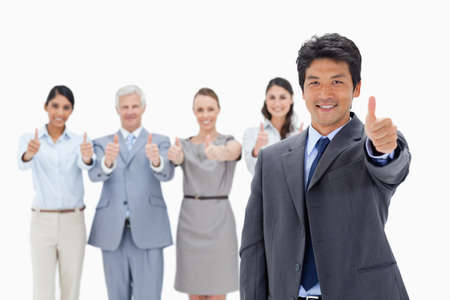 thumbsup: Close-up of a business team with their thumbs-up with a smiling Asian man in foreground against white background