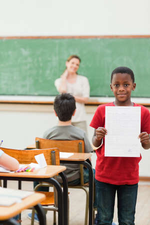 the pupil: Elementary pupil showing his exercise sheet