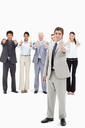 thumbsup: Multicultural business team with their thumbs-up focus on a man in foreground