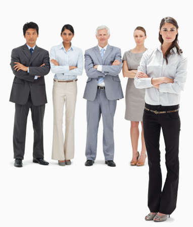 arms folded: Business team with their arms folded with a woman in foreground against white background LANG_EVOIMAGES