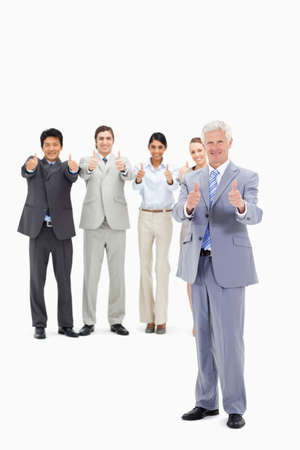 thumbsup: Multicultural business team with their thumbs-up with a mature man in foreground LANG_EVOIMAGES