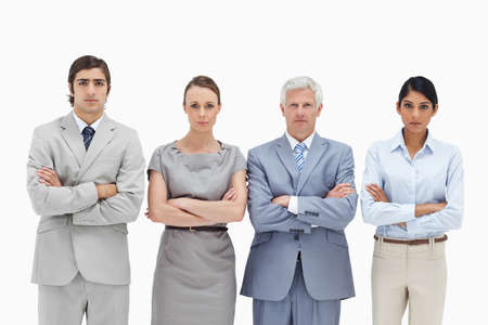 four people: Multicultural business team crossing their arms against white background LANG_EVOIMAGES