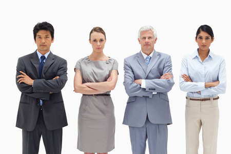 arms folded: Multicultural business team with their arms folded against white background