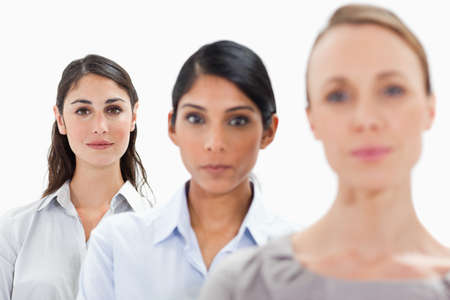 single line: Close-up of businesswomen in a single line with focus on the last person against white background