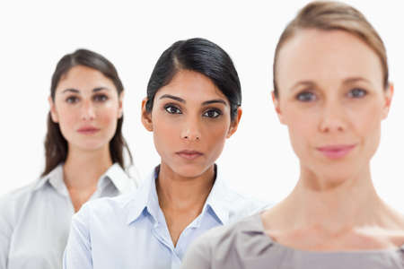 single line: Close-up of businesswomen in a single line with focus on the middle person against white background