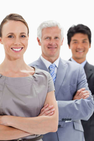 single line: Smiling business people in a single line with focus on the first person against white background LANG_EVOIMAGES