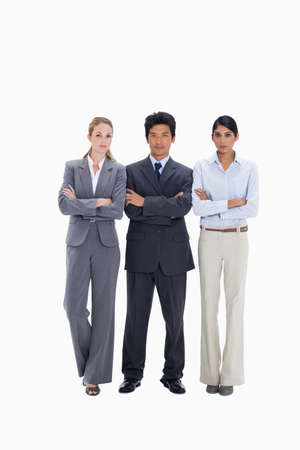 confident business woman: Business people with their arms folded against white background LANG_EVOIMAGES