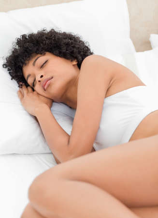 frizzy: Attractive frizzy woman sleeping in a white bed LANG_EVOIMAGES