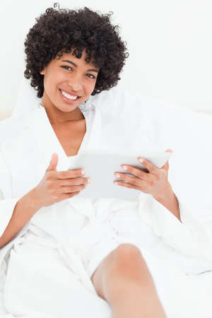 frizzy: Frizzy haired woman with a touchpad in a robe