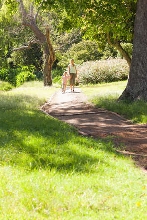 far away: A far away shot of a mother and daughter walking down a path LANG_EVOIMAGES