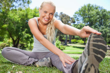 warming: Smiling young sportswoman warming up