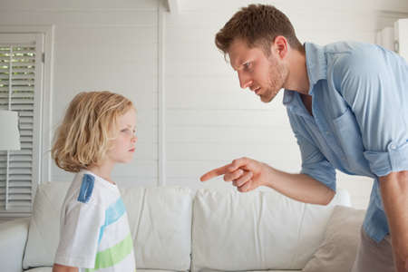 misbehaving: Son looks out the window as his father punishes him for misbehaving