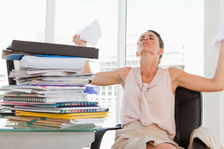 too much work: Female with too much work goes crazy in a bright office