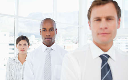 salespeople: Young salespeople standing in a row LANG_EVOIMAGES