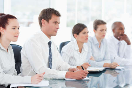 salespeople: Young salespeople sitting in a meeting