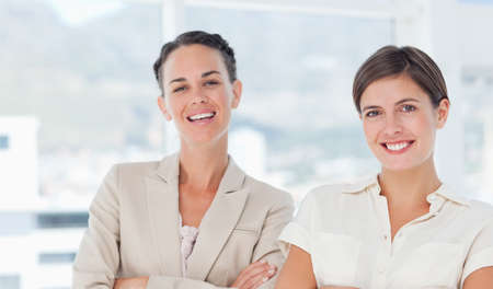 saleswomen: Smiling saleswomen standing together LANG_EVOIMAGES