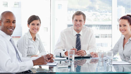salespeople: Smiling young salespeople in a meeting