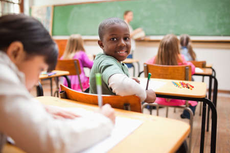 the pupil: Young pupil turning around during lesson