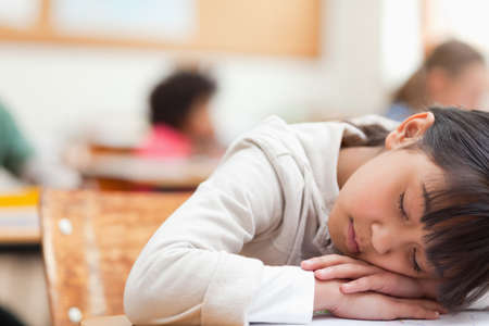 taking nap: Elementary student taking a nap in class