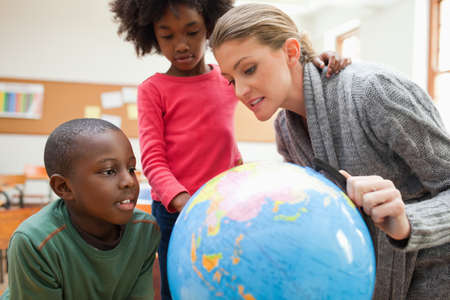 teaching adult: Elementary teacher explaining the world to students