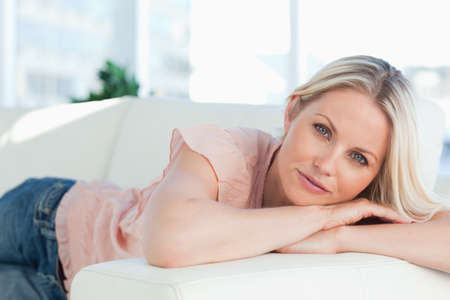 bright eyed: Blue eyed lady lying on her sofa in a bright living room