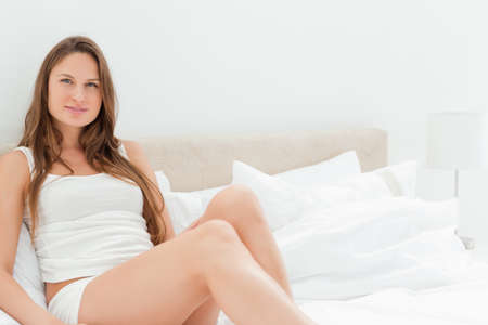 voluptuous: Voluptuous young women sitting on her bed