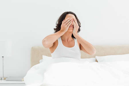 woken: Attractive woman rubbing her eyes as she has just woken up LANG_EVOIMAGES