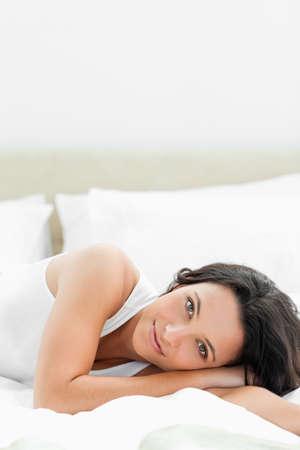 wellness sleepy: Angelic woman lying on her bed