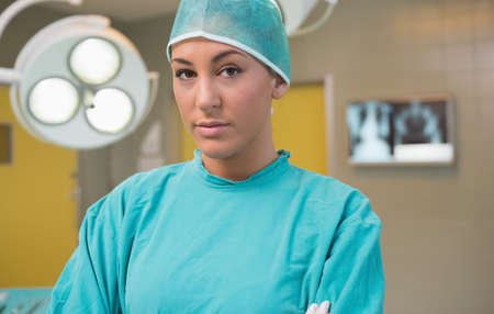 surgical nurse: Nurse wearing a surgical equipment in an operating theater LANG_EVOIMAGES