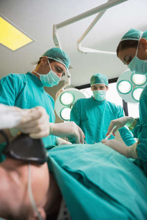 operating theatre: Focus on surgeons operating in an operating theatre