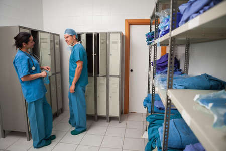 check room: Surgeons talking in a locker room in a hospital