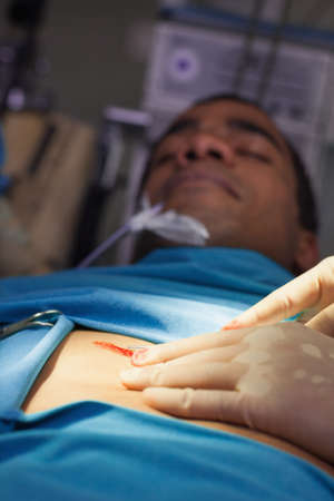 operating table: Unconscious male patient on an operating table in a hospital LANG_EVOIMAGES