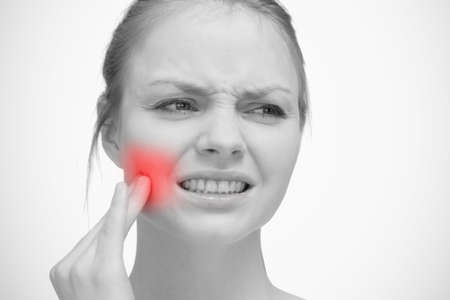 throbbing: Woman touching red highlighted toothache in black and white LANG_EVOIMAGES