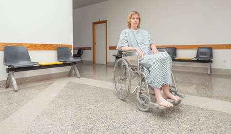 paraplegic: Patient sitting on a wheelchair in a corridor LANG_EVOIMAGES