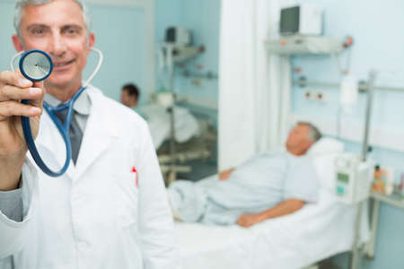 recuperation: Doctor showing a stethoscope in a hospital ward