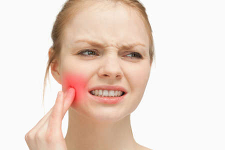 throbbing: Woman touching highlighted toothache on white background