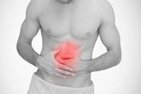 man stomach ache: Man with highlighted red stomach ache in black and white