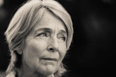 forlorn: Forlorn older woman in black and white LANG_EVOIMAGES