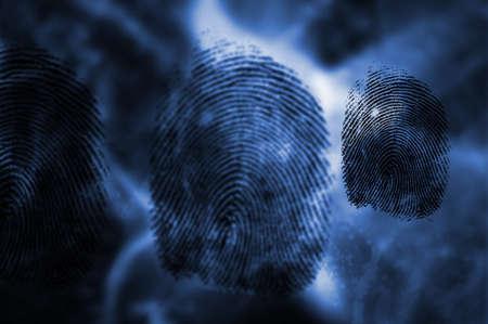 fingerprints: Three black fingerprints on blue digtial background LANG_EVOIMAGES
