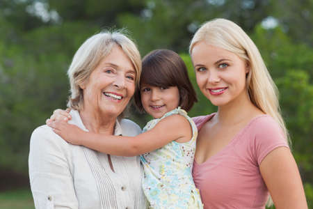 three generations of women: Three generations of women portrait outside in the park