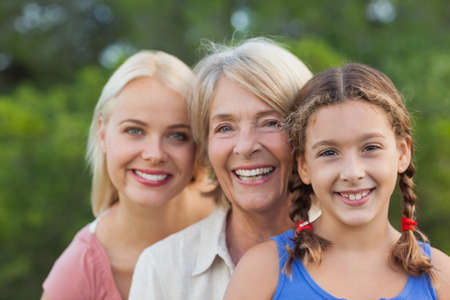 three generations of women: Three generations of women smiling portrait outdoors in the countryside