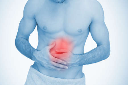 man stomach ache: Man with highlighted red stomach ache in blue tint
