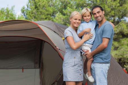 campsite: Couple with cute blonde son on camping holiday at the campsite portrait