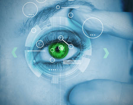 green eye: Woman stretching her green eye for a security identification LANG_EVOIMAGES
