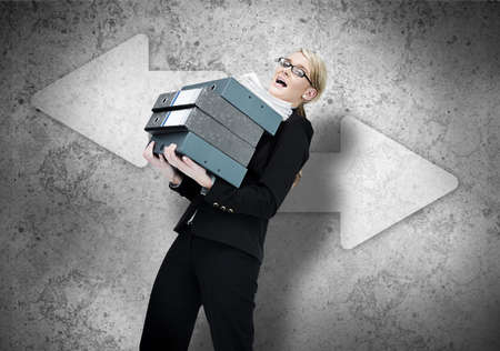 work load: Woman struggling with work load on grey background with white arrows